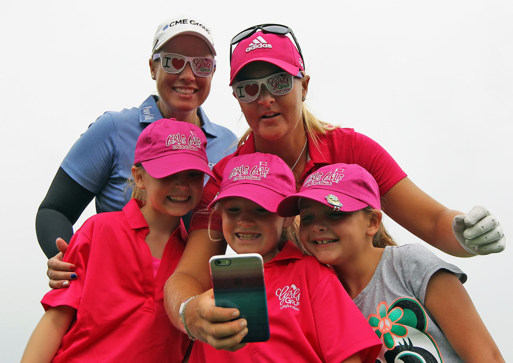 Golfers Brittany Lincicome, back left, and Anna Nordqvist, take a selfie with Ella Will, 10, front left, Callie Will, 8, and Hannah Hoover, 8, all of Enola, during practice rounds of the 70th US Women's Open at Lancaster Country Club Wednesday July 8, 2015. (Photo/Chris Knight)