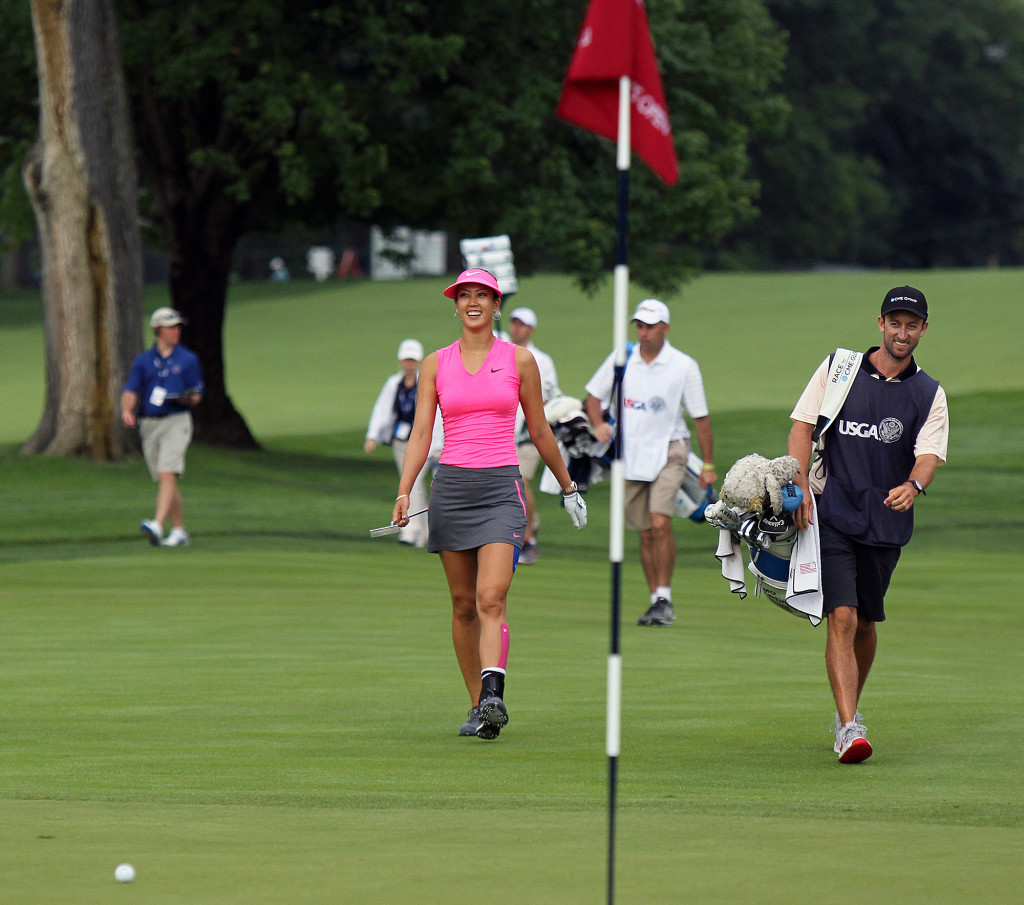 Michelle Wie, is all smiles as she walks up onto the 1st green, during first day action of the 70th US Women's Open at Lancaster Country Club Thursday July 9, 2015. (Photo/Chris Knight)