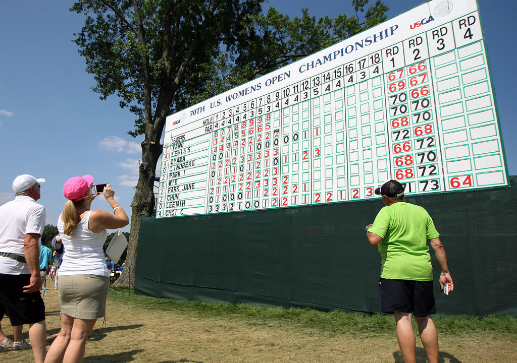 Fans check the scores at the 18th hole leader board, during third day action of the 70th US Women's Open at Lancaster Country Club Saturday July 11, 2015. (Photo/Chris Knight)