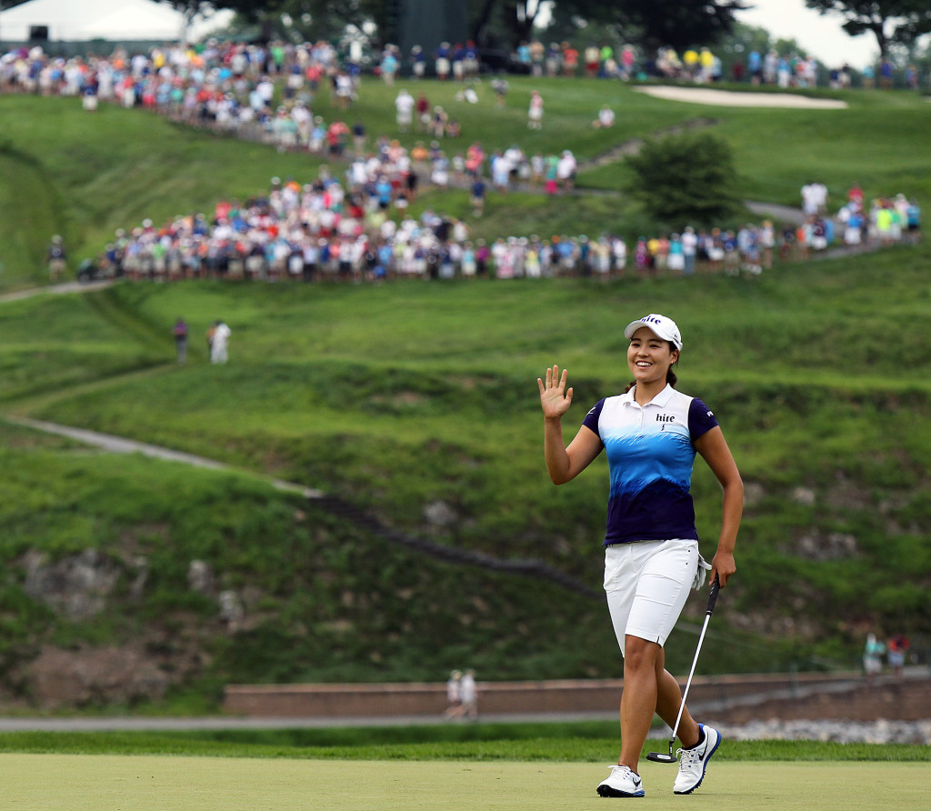 In Gee Chun, waves to the crowd after a birdie on the 3rd hole, during final day action of the 70th US Women's Open at Lancaster Country Club Sunday July 12, 2015. (Photo/Chris Knight)