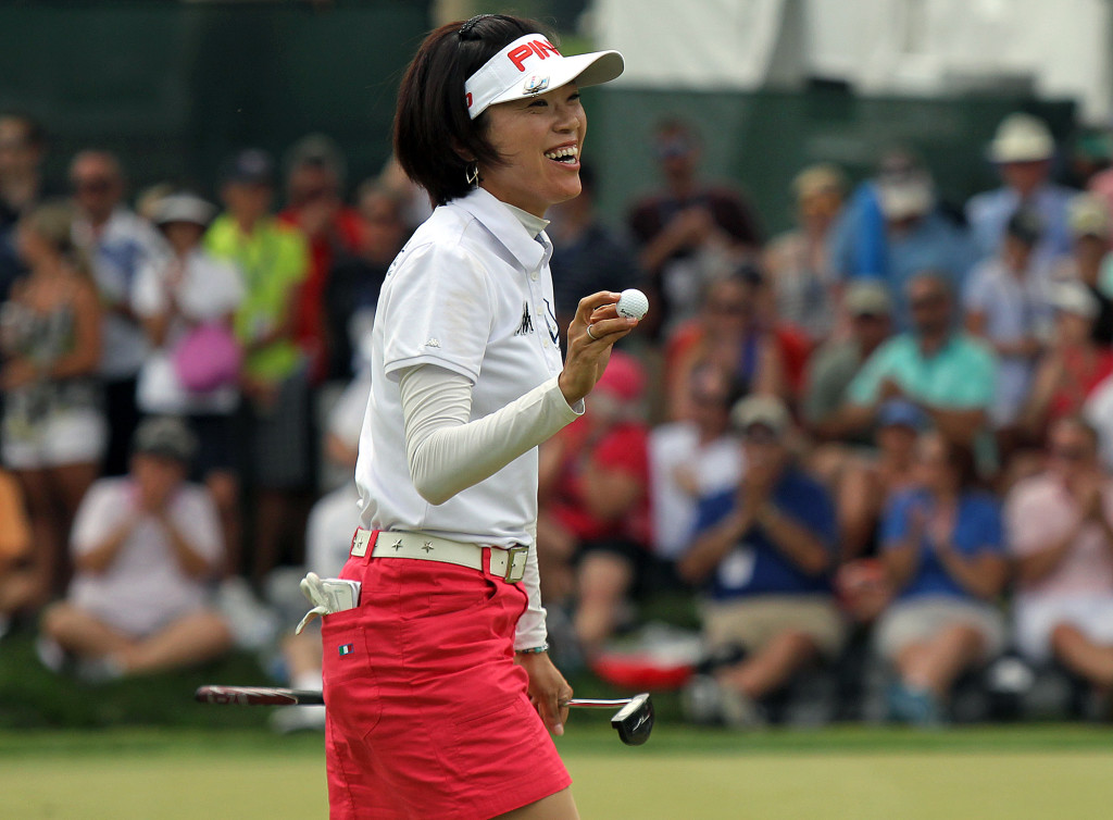 Shiho Oyama, acknowledges the crowd after a birdie on the 6th hole, during final day action of the 70th US Women's Open at Lancaster Country Club Sunday July 12, 2015. (Photo/Chris Knight)