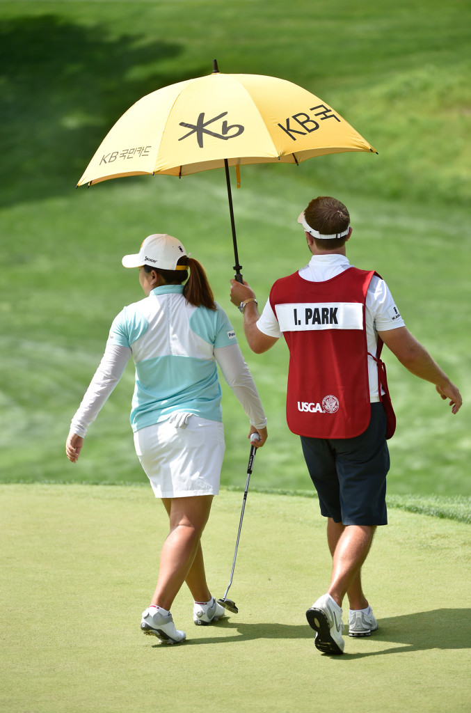 Inbee Park and caddie survey the fourth green while trying to keep cool during the opening round of the US Women's Open at Lancaster Country Club on Thursday, July 9, 2015. (Photo/Suzette Wenger)