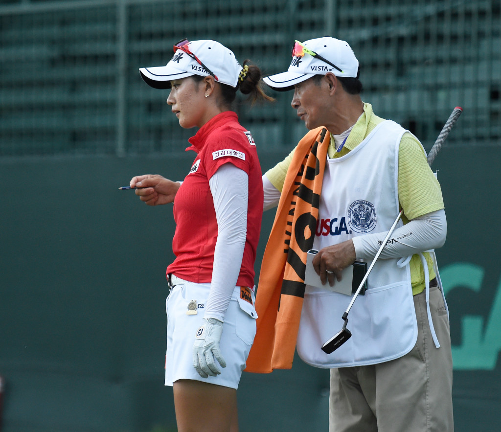 Chella Choi and caddie try to pick a line to land her chip shot from behind the eighth green during the opening round of the US Women's Open at Lancaster Country Club on Thursday, July 9, 2015. (Photo/Suzette Wenger)
